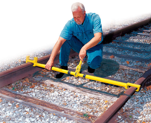 Aldon railroad gauge pusher and puller pushes on rail head for aligning rails