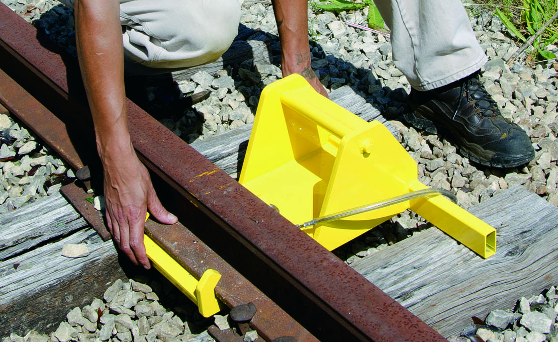 Aldon railroad alignment craddle for aligning rails with track toe jack