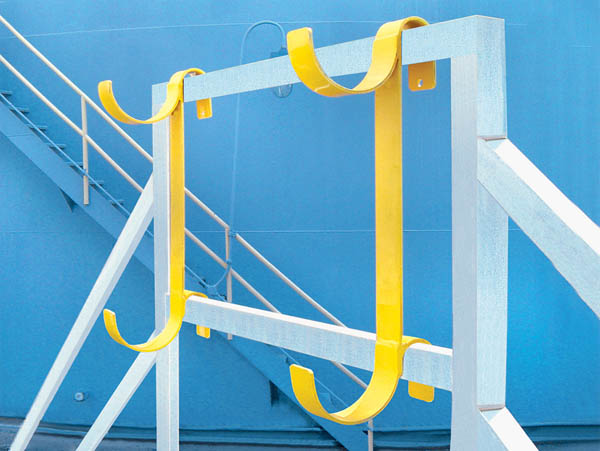 Aldon railcar hose rack for storage of tank car hoses on railings