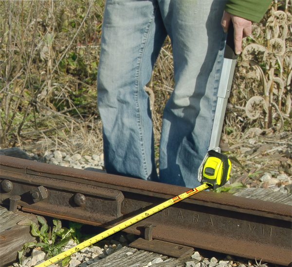 Aldon tape measure holder for railroad rail inspection and measuring